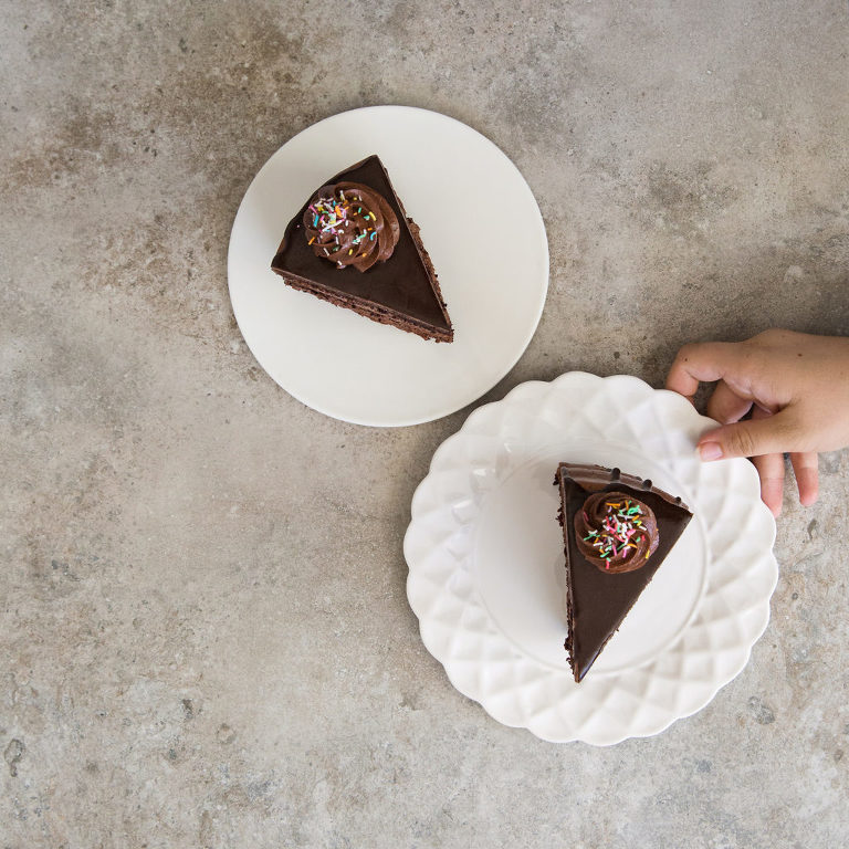 Slices of chocolate cake from Fifi la Femme photographed by Renee Bell
